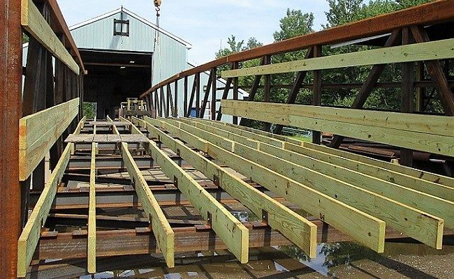 photo of a wooden bridge under construction