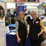 photo of CES employees at the umaine career fair booth