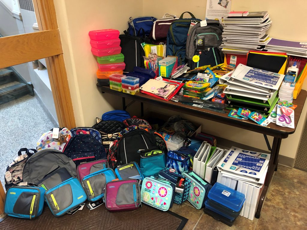 photo of table covered in school supplies for the united way school supply drive