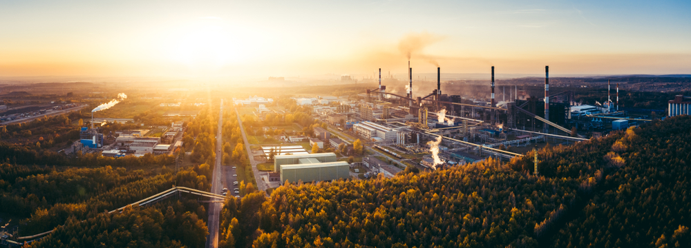 Air Emissions aerial photo of industrial mill site at sunset