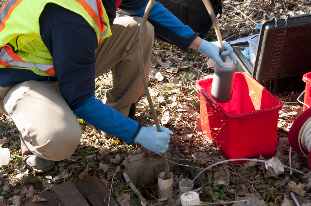 PFAS Sampling & Analysis photo of engineers out working in the woods with specialized equipment