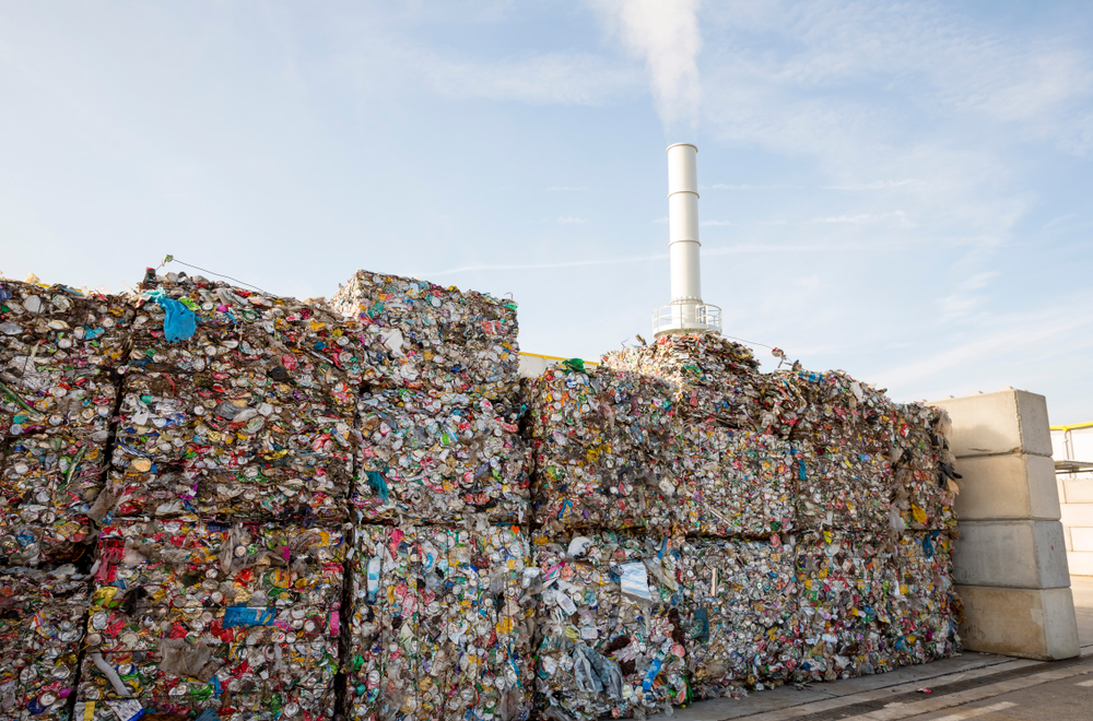 photo of giant cubes of trash at an industrial plant
