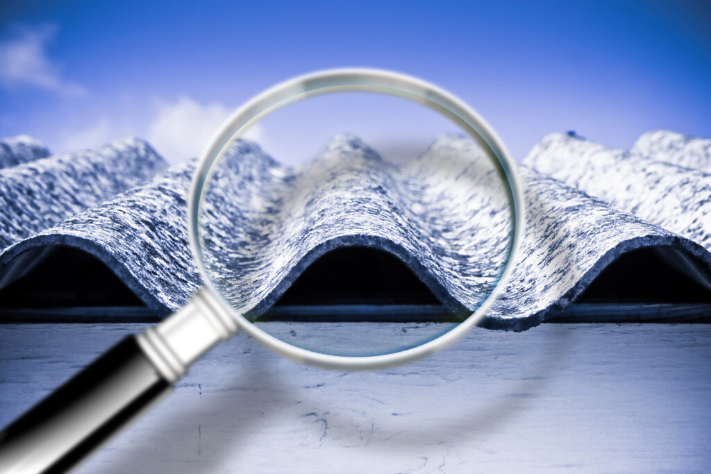 graphic of a magnifying glass zooming in on wavy asbestos lead Based Paint and PCB Management