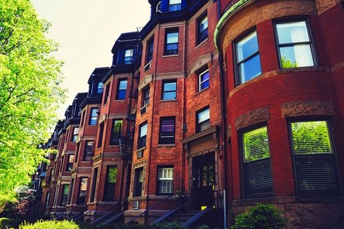 photo of brick apartment buildings along a street