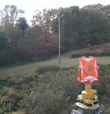photo of surveying equipment near emera power lines