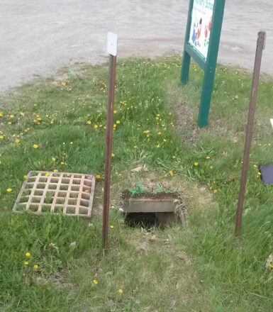 photo of sewer grate removed from sewer entrance