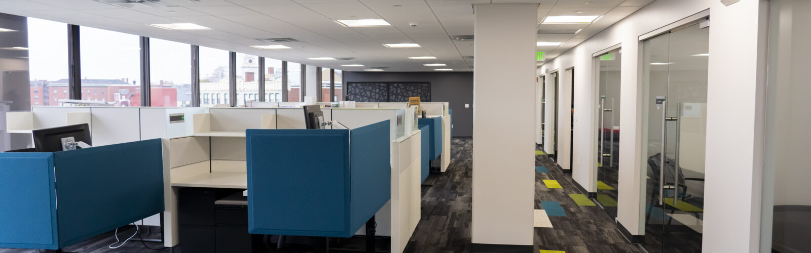 photo of office space with cubicles and glass doors