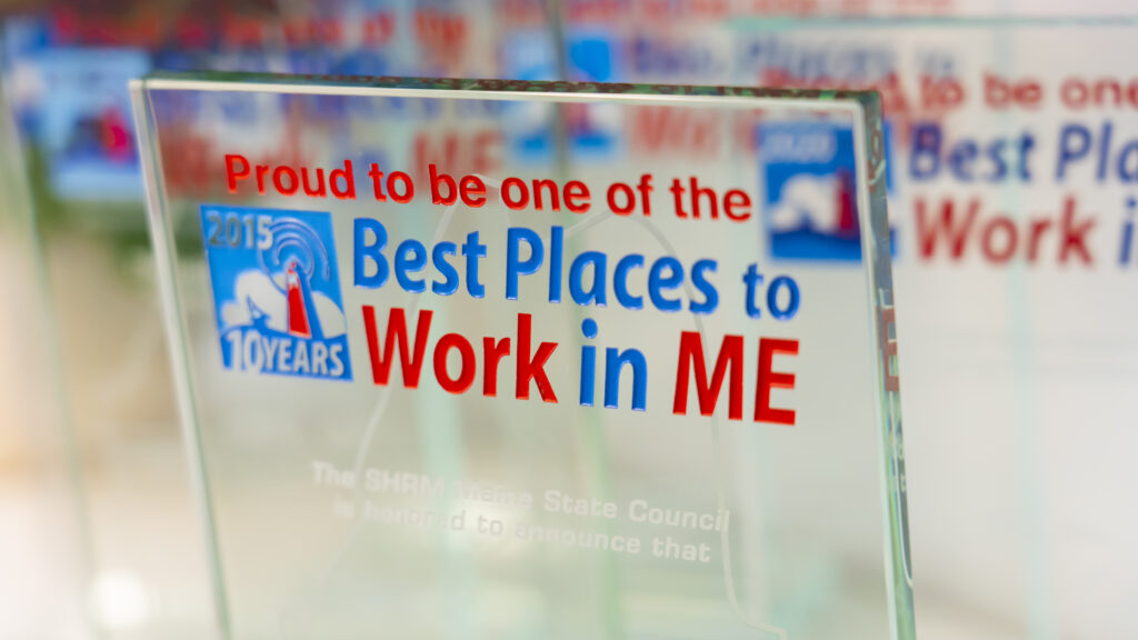 up close photo of proud to be one of the best places to work in maine 2015 award