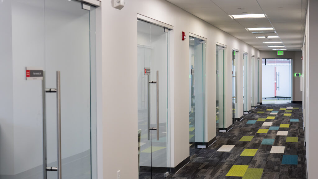 photo of hallway with glass doors in office space
