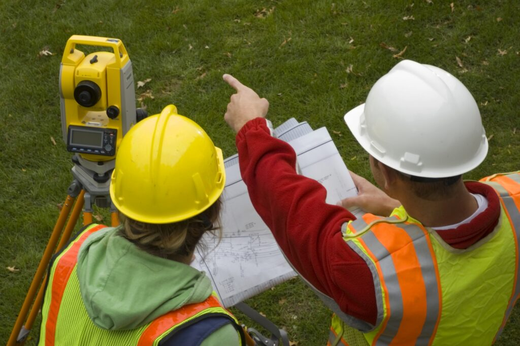 photo of an engineer and surveyor working in the field