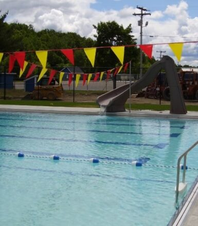 photo of a municipal swimming pool with a slide
