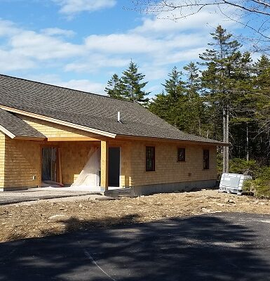 photo of a large building in the woods at schoodic point