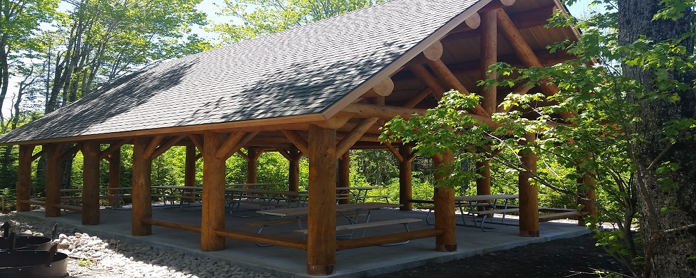photo of a log gazebo building at schoodic