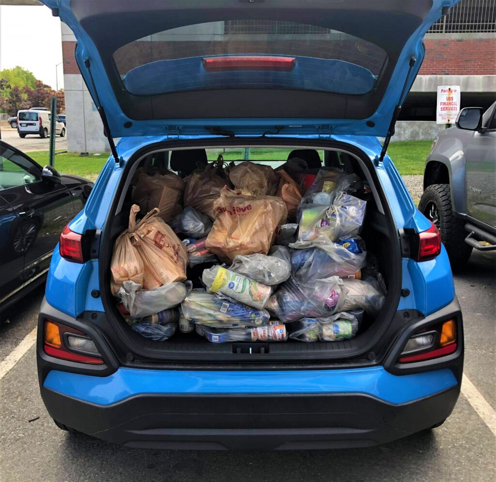 photo of back of car filled with groceries for the united way drive-thru food drive