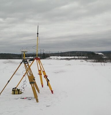 photo of survey equipment out in a snowy field